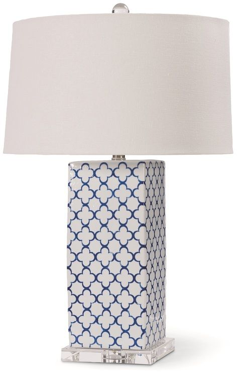 """Squared ceramic lamp base painted with a cobalt blue and white quatrefoil pattern, perched on a luxury crystal glass base, creating this 27"""" tall glamorous beach house lamp."""