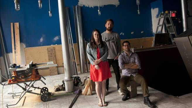 Laura MacDonald, Andrew Connell and Christopher Reynolds, pose Thursday at the future site of their business, the Stillwell Beer Bar, on Barrington Street in Halifax. (ADRIEN VECZAN / Staff)