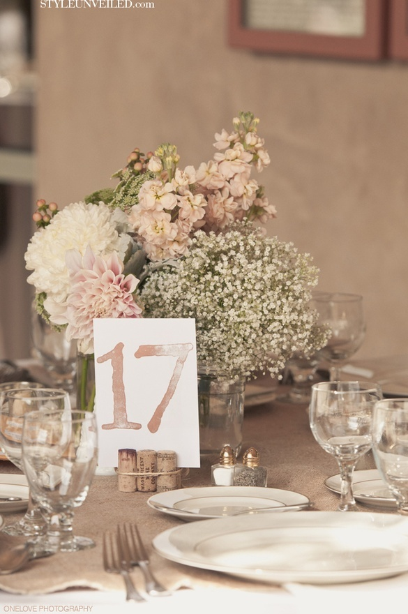 Mixed Vases and Babys Breath Wedding Tablescape. wine cork number holders. Love the table numbers!