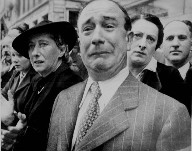 A Frenchman weeps as German troops march into Paris June 14, 1940