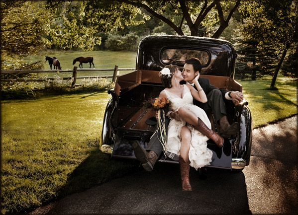 I want a pic like this!!! Even tho I don't want to wear cowboy boots in my wedding I'd love to get some pix with them in my dress!!