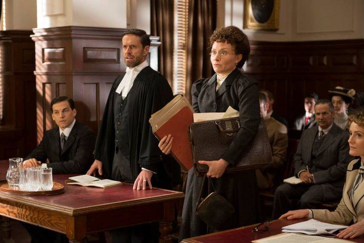 Leslie Garland (Giacomo Gianniotti) and the Crown Attorney (James Downing) look on as lawyer Clara Brett Martin (Patricia Fagan), the first female lawyer in the British Empire, enters the courtroom