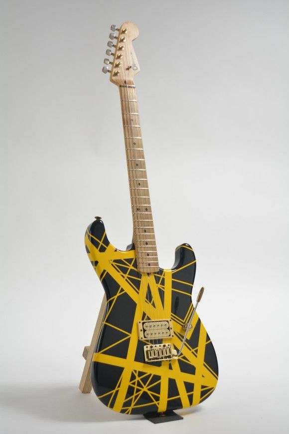 A yellow-and-black Charvel guitar, customized for Eddie Van Halen in the 1980s, could bring $60,000 to $80,000. The original bill of sale made out to Van Halen is included. This undated photo provided by Guernsey's auction house shows a yellow-and-black Charvel guitar, customized for Eddie Van Halen in the 1980s It could bring $60,000 to $80,000 when it goes up for sale on Feb. 27, 2016, in New York. (Guernsey's via AP)
