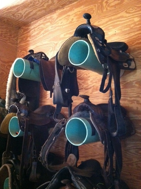 Great way to store things in a working tack room, could put all kinds of things inside PVC pipe, now just how to attach it...