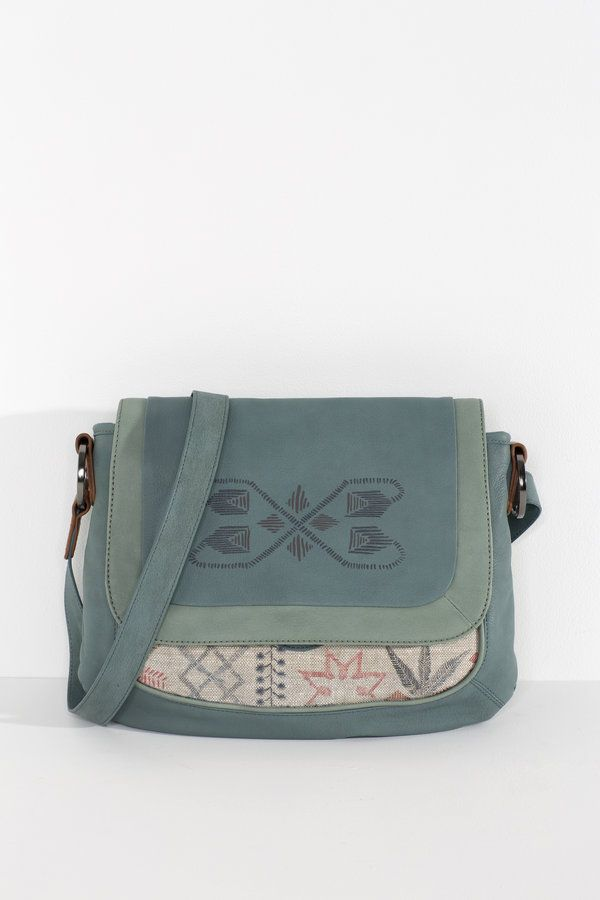 Perfectly shaped mid sized day bag. Front flap with printed leather, with a little peak of digitally printed Belgian linen underneath  soft drum dyed...