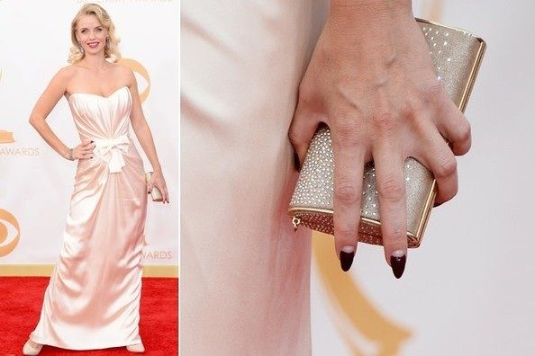 Kelli Garner Kelli Garner's vampy pointed nails with clear half moon designs added an edgy, sexy element to her red carpet look.