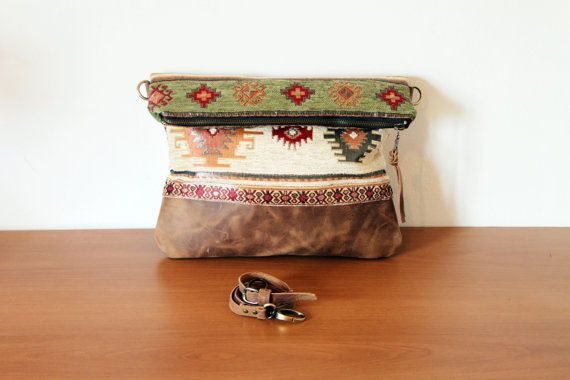 Ethnic style, heavy weight, bright, chenille upholstery fabric with geometric patterns and distressed brown leather for the insert and strap. It