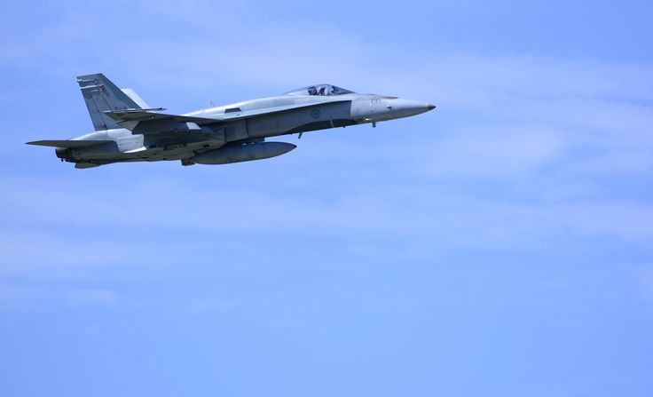 Tail Number (791): A CF-18 Hornet fighter jet does a familiarization flight of the region in Câmpia Turzii, Romania during NATO reassurance measures on May 13, 2014.   Photo by MCpl Patrick Blanchard, Canadian Forces Combat Camera (IS2014-3023-10)