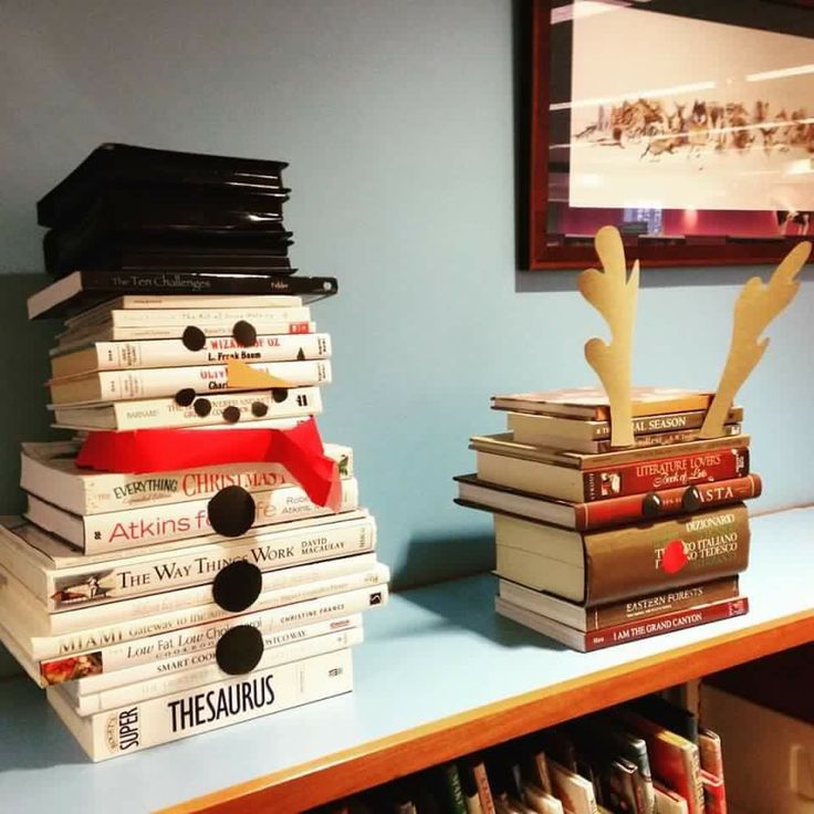 Snowman and reindeer made out of books and dvd cases. So cute!