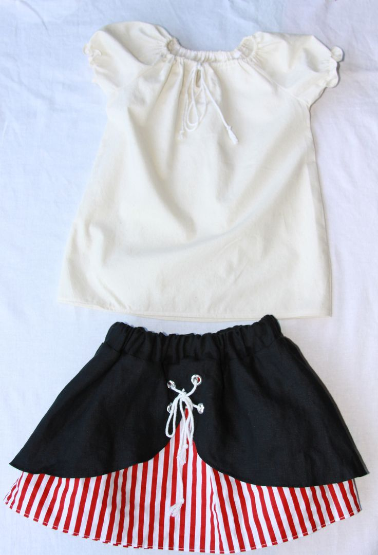 Pirate girls costume peasant blouse and red and white striped skirt with black contrast. Decorative drawstring on both the blouse and skirt! Super cute pirate outfit for girls 6m-4t. Buy one for your little pirate for fun or for a ren fair. https://www.etsy.com/listing/222463036/red-and-white-striped-toddler-pirate?ref=shop_home_active_16