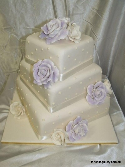 3 Tier Wedding cake  kind of like this but with theme colour and diff flower deco