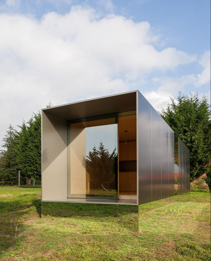 Prefabricated Building Raised On A Mirrored Plinth Above A Grassy  Portuguese Landscape. Prefabricated HousesPrefab ...
