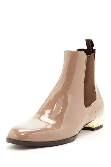 Love everything about the Chelsea Booties.  The nude patent is unexpected and the gold heel is perfection.