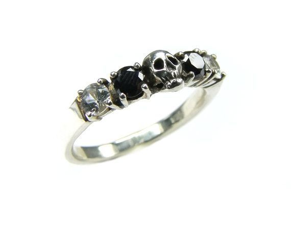 The perfect scary skull wedding ring with diamonds for your dark bride! One little hand carved skull is accompaigned by black diamonds and white