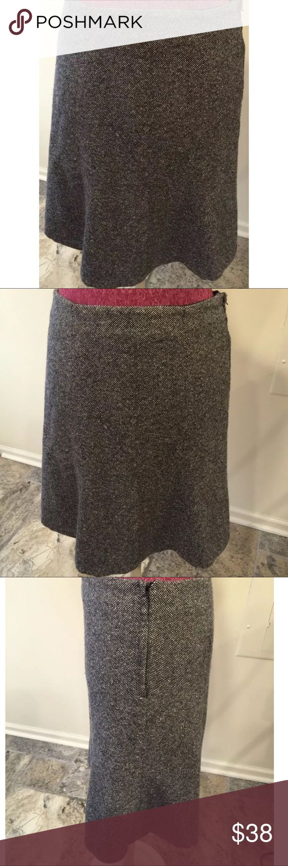 Gap Black Trumpet 54% Wool Skirt Size 8 Gap Size ~ 8 Shell ~ 54% wool, 17% polyester, 15% nylon, 12% silk, 2% other fibers Lining ~ 100% acetate Waist ~ 15 Hips ~ 20 Length ~ 22 Back zipper Black GAP Skirts A-Line or Full