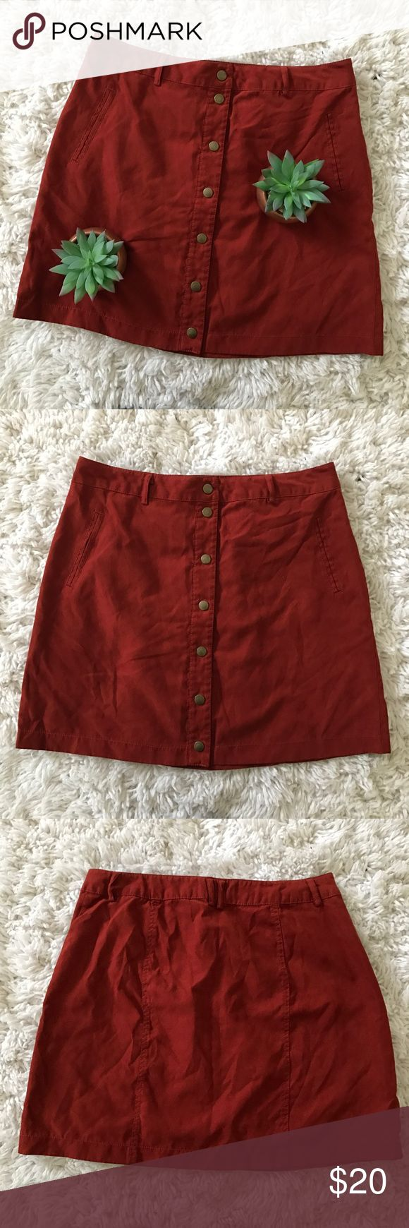 Forever 21 • Button Down Skirt Forever 21 • Button down, mini skirt from Forever 21. Burnt orange in color. Silk linking inside. Buttons are snaps. Faux suede material. Great condition & perfect for you hipsters out there.   ❄️ No trades. Feel free to make an offer. Bundle items for 15% discount. ❄️ Forever 21 Skirts Mini