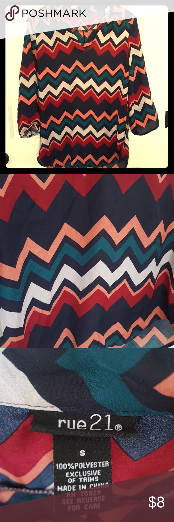 Rue 21 3/4 sleeve chevron top EUC small rue 21 polyester top. Navy with bold chevron print in peach, red, white and Mediterranean blue. Can be worn with jeans, dress pants, leggings. Very versatile! Be sure to SHOP my closet for matching items. ☆ITEMS ADDED DAILY☆BUNDLE AND SAVE☆  See something you like? ☆☆MAKE AN OFFER!☆☆ Don't forget to LIKE it so you can GRAB it during a SHIPPING DISCOUNT or PRICE DROP!  I'm happy to answer any questions you may have. Rue 21 Tops