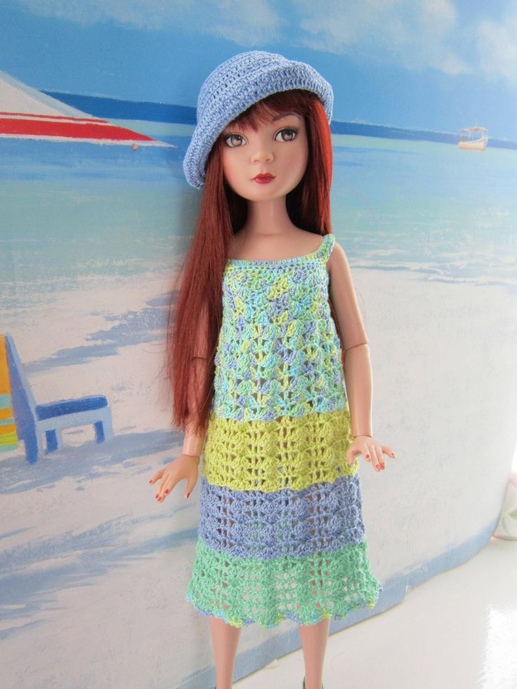 Prue in her dress in shades of aqua, blue and green. She thinks the hats just tops it off beautifully!!