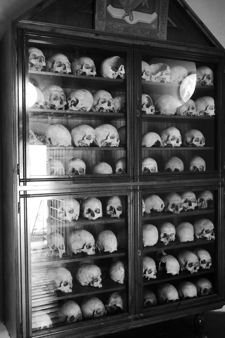 Human skulls in a commemorative shrine for victims of the 1866 Arkadi massacre, Crete. It's not known if these are the heads of Turkish aggressors or Cretian Monks, but the various bullet-holes and other injuries leave no doubt that many died in battle. Quite a place.