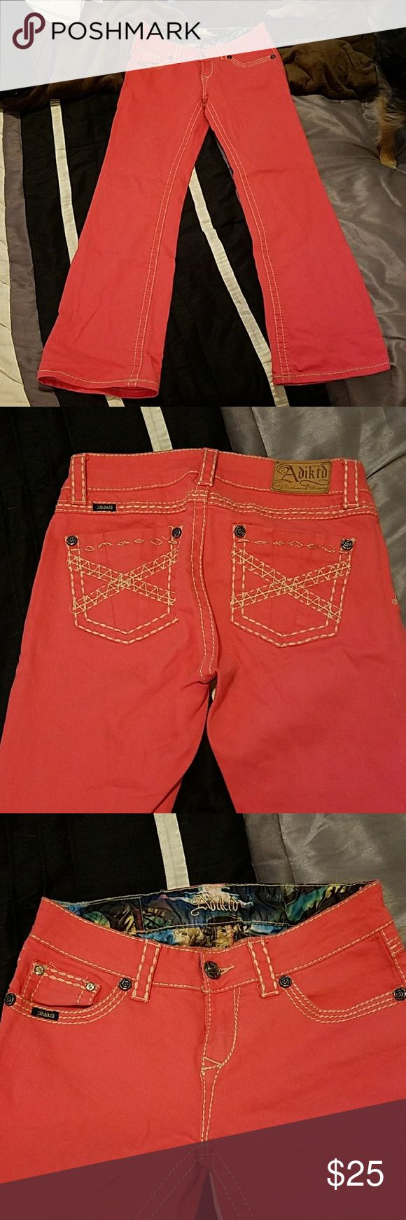 Coral colored boot cut jeans Like new boot cut jeans. Worn them once. My body type doesnt go well with coral boot cut :) cute butt pockets and rose and diamond buttons Jeans Boot Cut