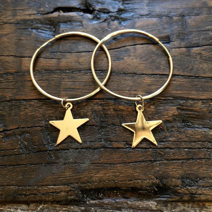 "Gold filled star charms on gold filled hoop earrings. Hoop size 1.25"" So adorable and eye catching!"