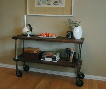 """Vintage console Table: Unique custom made console table. The wood is solid 1.5"""" thick African Mahogany and has a vintage tung oil finish. This table could also be a short bookshelf or bookcase. The 5? casters make it easy to move around and are gentle on flooring. Dimensions are 4? x 14? x 30?"""