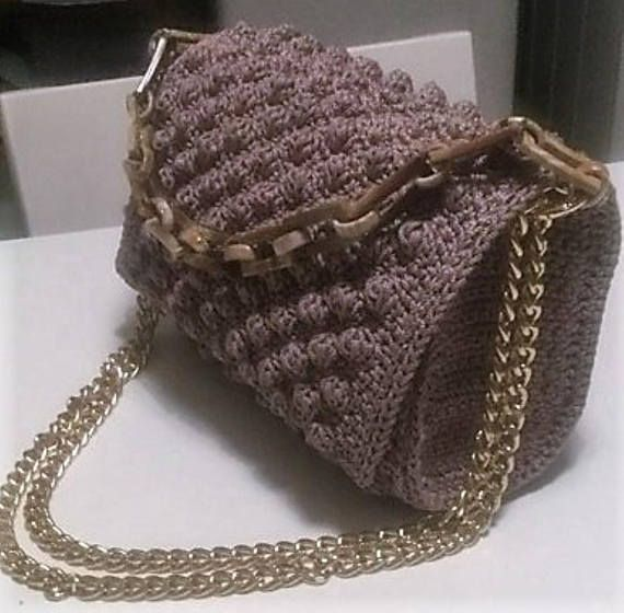 Crocheted womens handbag in Coco Chanel-inspired style, with Bubble Stitch in beige color. From yarn macrame and crocheted n.2.5 hook. The bag has mesh reinforcement and fabric lining, a gold metal chain and a second bony chain for the hand, which are removable and adjustable. A very stylish