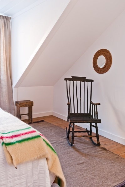 Traditional Portuguese blanket and antique rocking chair, bedroom, Ultramar apartment, Baixa House    www.baixahouse.com