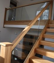 Oak open riser staircase with embedded glass