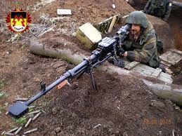Sparta batalion member with Kord heavy machine gun .
