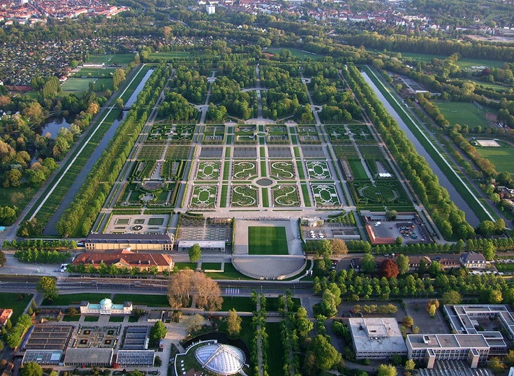 Great aerial of the Royal Gardens in Hanover, Germany. Seen are the Great Garden, and parts of the Berggarten. Started in 1638 as a vegetable garden for Duke Georg von Calenberg, added-on to by his son Johann Friedrich in 1655, and expanded to roughly its current size between 1676 and 1710 by Duke Ernst Augustus for his wife Duchess Sophie von der Pfalz.