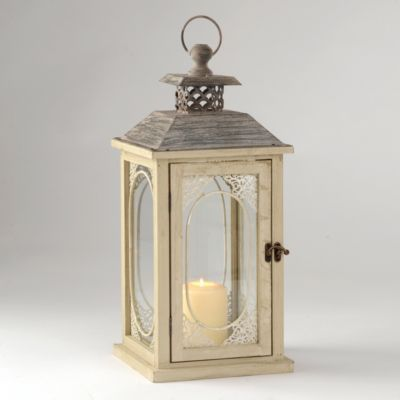 The romantic Antiqued Cream Lantern features a gorgeous lace detail on its hinged door. Imagine a candle's soft glow illuminating that pattern on this beautiful lantern! #kirklands #SpringisintheAir