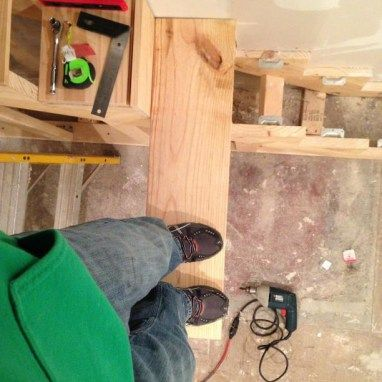 Testing the floating stairs strength before the new treads come in.