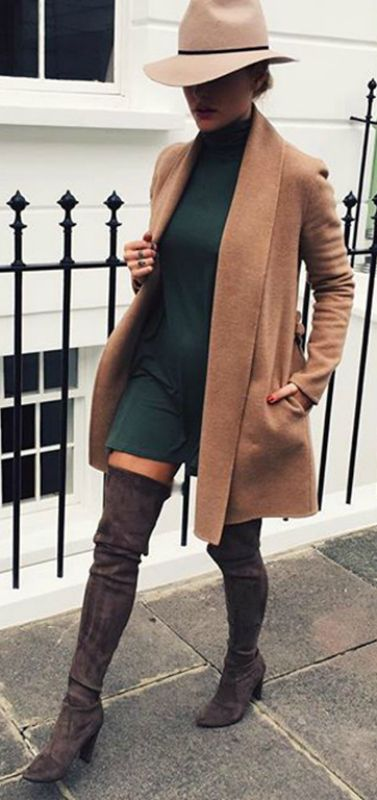 Caroline Receveur wears a beige coat with a turtle neck mini dress and over the knee boots. Brands not specified.