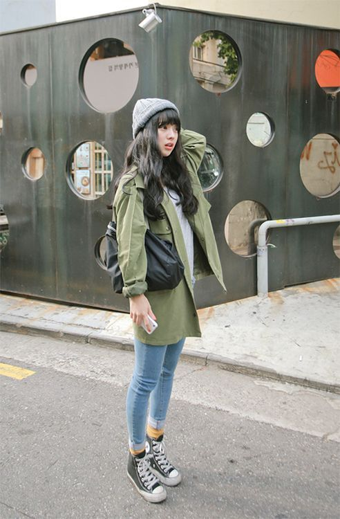 Rock a green trenchcoat with light blue skinny jeans to create a chic, glamorous look. For footwear go down the casual route with black and white high top sneakers.  Shop this look for $112:  http://lookastic.com/women/looks/beanie-trenchcoat-crew-neck-t-shirt-tote-bag-skinny-jeans-socks-high-top-sneakers/6420  — Grey Beanie  — Green Trenchcoat  — Grey Crew-neck T-shirt  — Black Leather Tote Bag  — Light Blue Skinny Jeans  — Mustard Socks  — Black and White High Top Sneakers