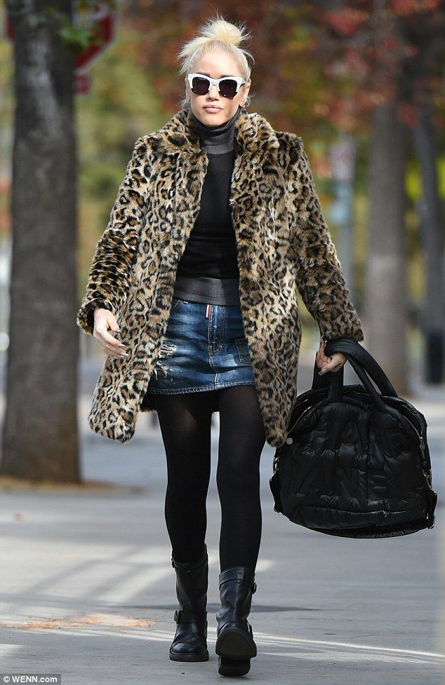 7a3612823 Gwen teamed her chic winter coat with a black-and-gray long-sleeve sweater,  a den.