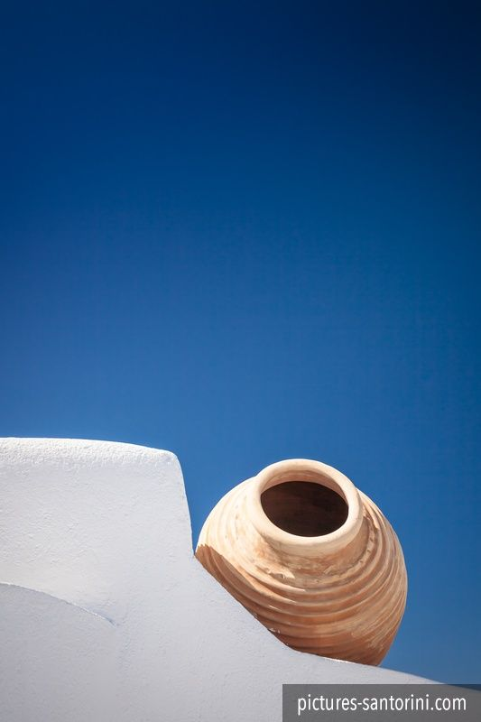 A typical Greek amphora against the deep blue sky.