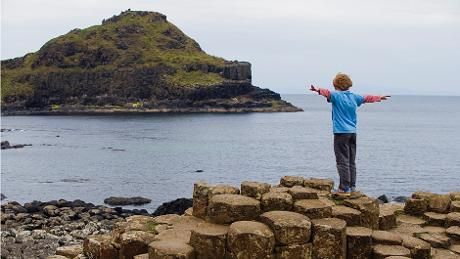 Picture shows a little boy on the causeway stones