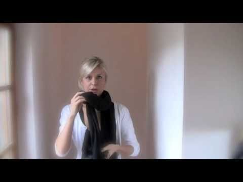 "How to Tie Your Scarf Like a Parisian. Also look at ""the Italian twist"" here http://girlsguidetoparis.com/archives/how-to-tie-your-scarf-like-a-parisian/"