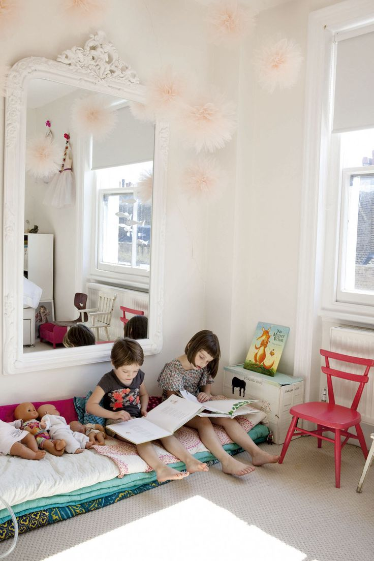 Reading nook.  Beautiful vintage bohemian inspired baby girl's nursery / little girl's room. Love the mirror & the paper pom poms x