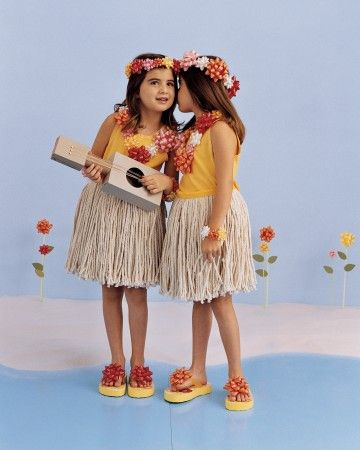 These girls were transformed into hula dancers in one afternoon. What's their secret? Their leis are made of vibrantly colored gift bows andtheir swinging skirts arefashioned from rope-style mop heads. The dancer on the left is even a ukulele player; her instrument is made out of recycled cardboard cereal boxes, a paper-towel tube, and rubber bands.