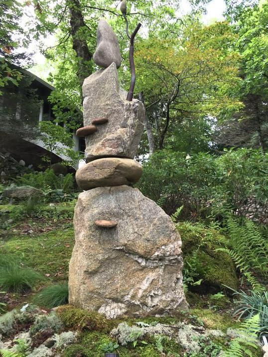 "Stone Sculpture:""Toward Light and Shade"" honors the resilience and multiple life sustaining properties of trees. The branch is forged steel and the shelf mushroom shapes are river stones."