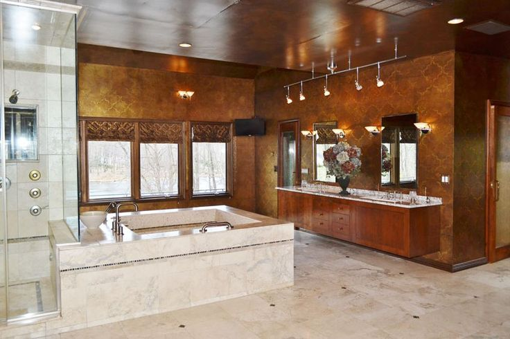 Craftsman bathroom with suspended cabinets, tub enclosure and contemporary track lighting