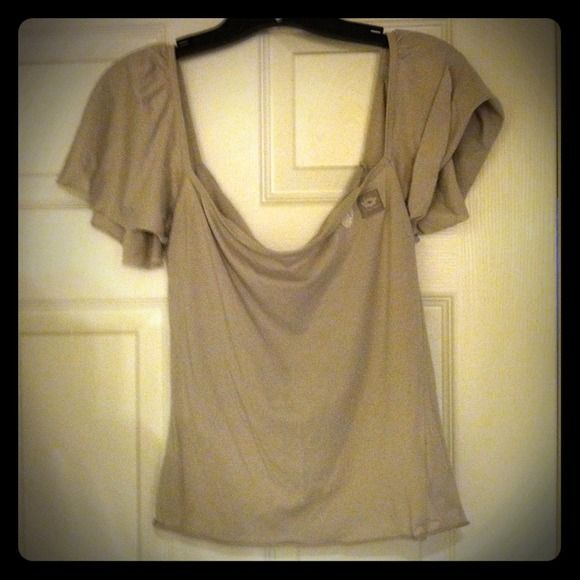 *reduced* Ultra cute Diesel top This dove grey top has never been worn, though I've owned it for years and years. It has a cute logo and flower detail on the left breast (see pic). I give discounts for bundles - just let me know!! Diesel Tops