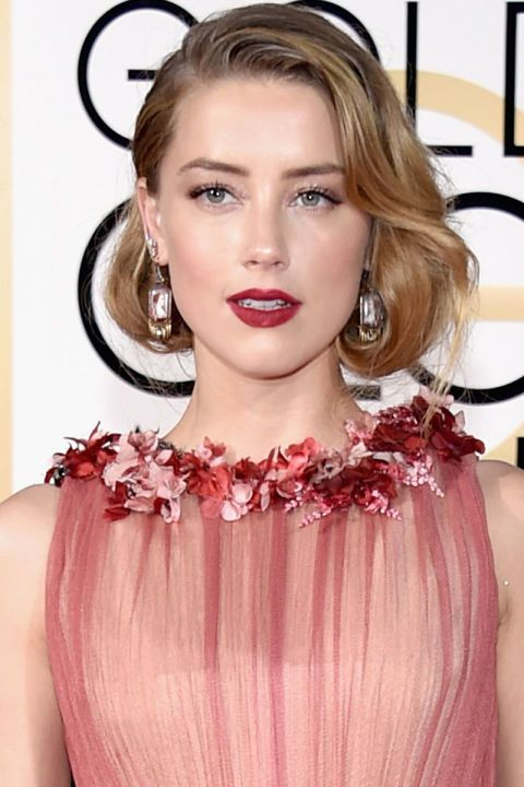 See the most glamorous beauty and hair looks from the 2016 Golden Globe Awards here: Amber Heard