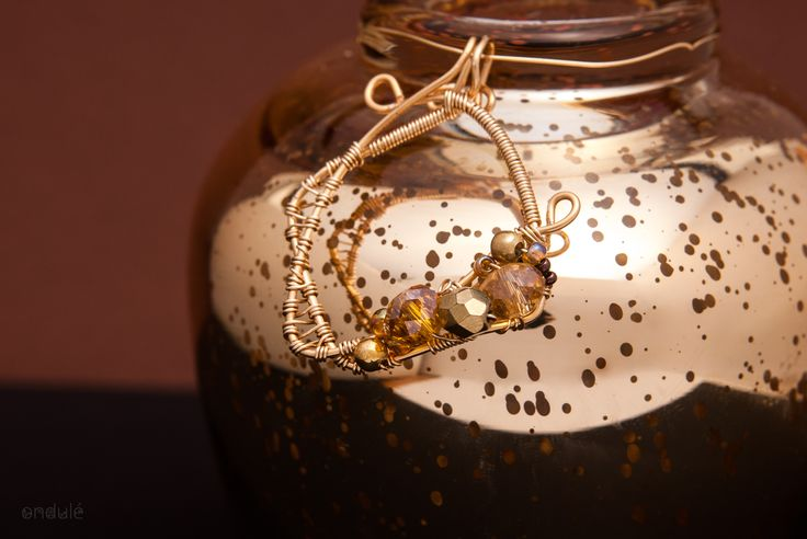 golden wire wrapped pendant