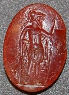 Sard gem engraved with a bearded warrior looking to the left, wearing a crested helmet and a short chiton; he holds a spear and rests his left hand on his shield; on the reverse is an inscription in Arabic (?) characters between a crescent and a star.