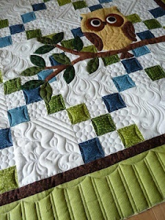 I love this! I really like the plain squares with the different quilting!