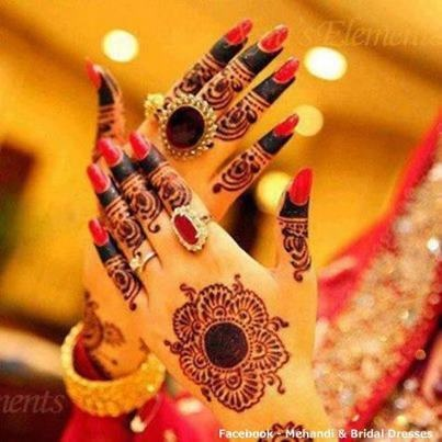 Bridal henna or mehndi designs with manicure. Love the statement ring