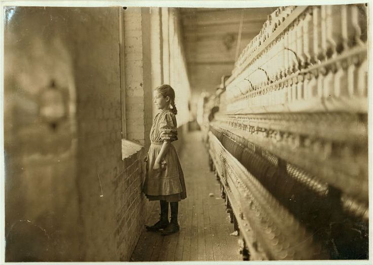 Ten-year-old Lalar Blanton, a textile worker, looks out the window of a North Carolina cotton mill in 1908. (Photo: Library of Congress/LC-DIG-nclc-01345)